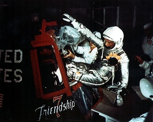 John Glenn being inserted into the Friendship 7 spacecraft