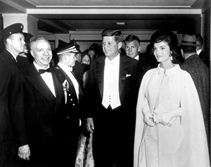 President and Mrs. Kennedy arrive at National Guard Armory for Inaugural Ball, 20 January 1961.