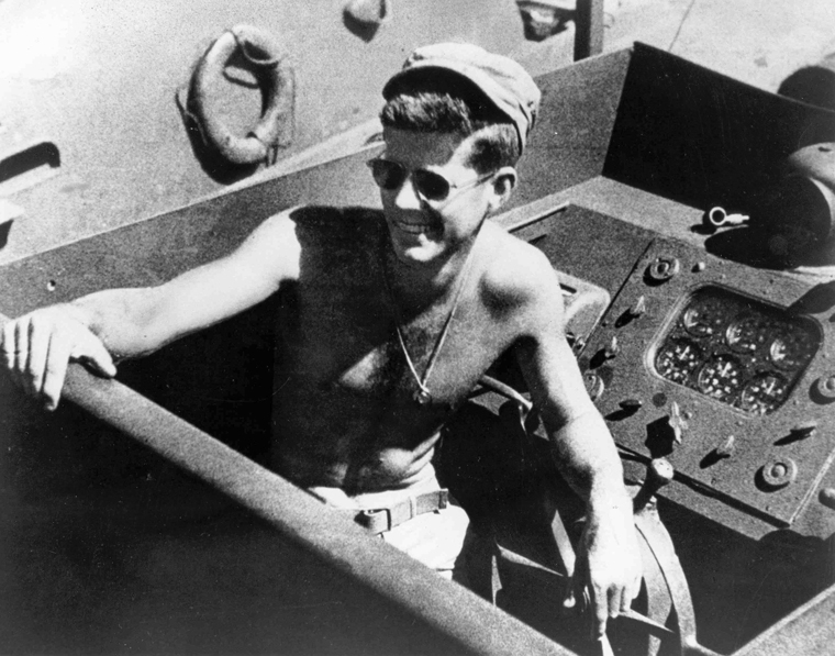 PC101  Lt. (jg) John F. Kennedy, at the wheel of the PT-109, Solomon Islands, 1943