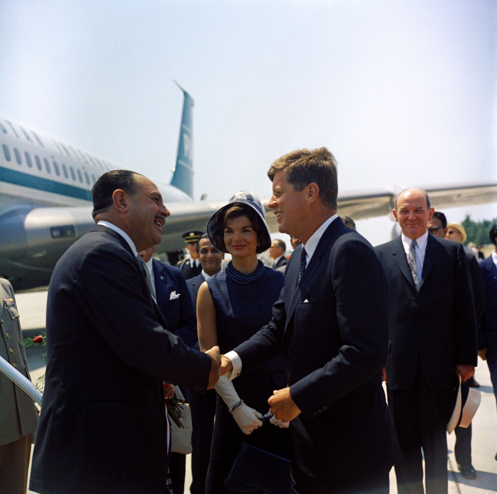 Arrival ceremonies for President Mohammad Ayub Khan of Pakistan. President Ayub Khan shakes hands with President John F. Kennedy; First Lady Jacqueline Kennedy; Secretary of State Dean Rusk (right, behind President Kennedy). Andrews Air Force Base, Maryland.