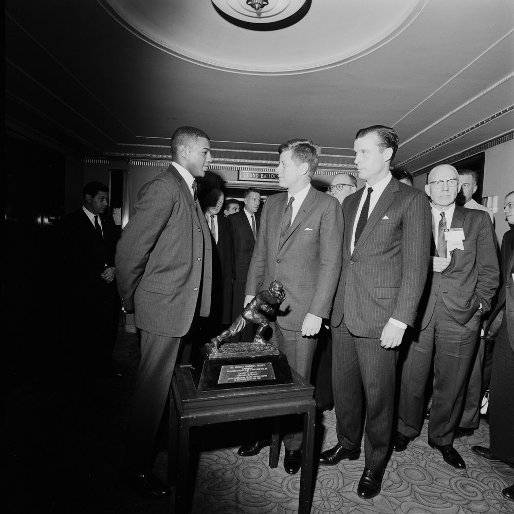 President Kennedy greets 1961 Heisman Trophy winner Ernie