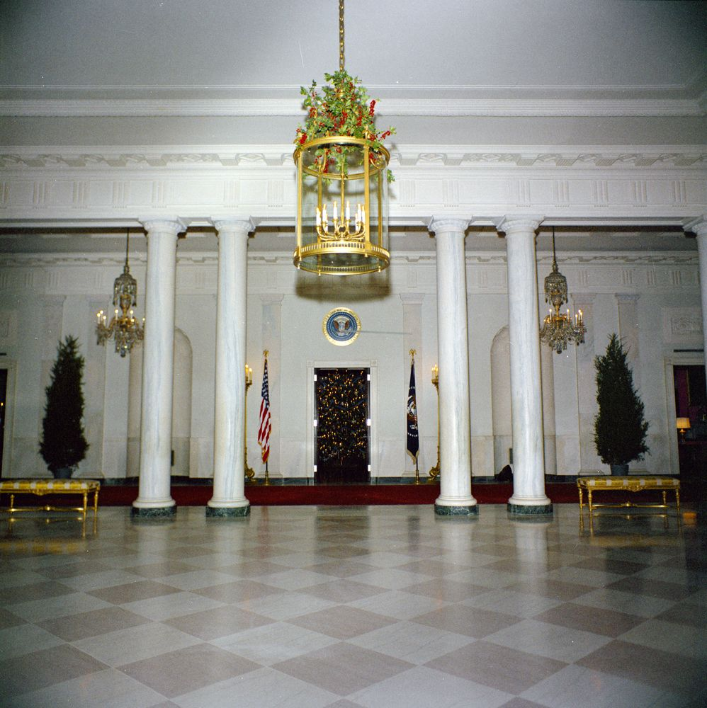 KN-C19721. Christmas Decorations In Entrance Hall Of White