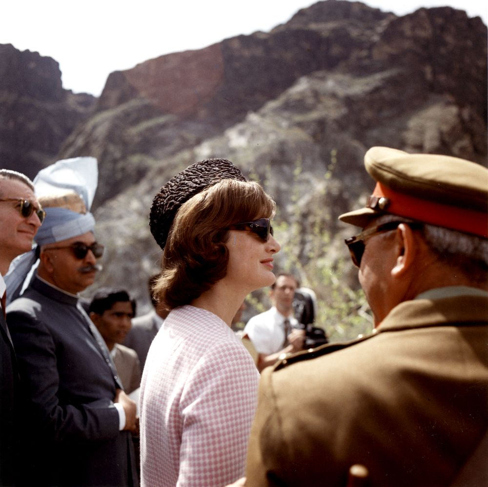 First Lady Jacqueline Kennedy visited the Khyber Pass near Pakistan's western border with Afghanistan. Standing at left: United States Ambassador to Pakistan, Walter P. McConaughy; Governor of West Pakistan, Malik Amir Mohammad Khan