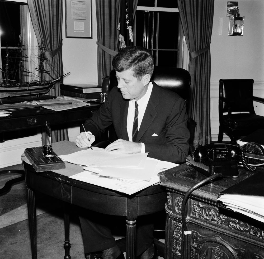 Executive Privilege And Presidential Aides: KN-25073. President John F. Kennedy Signs Equal