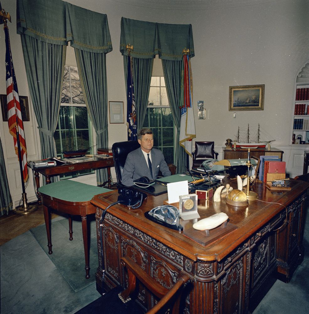 President John F Kennedy At His Desk In Oval Office