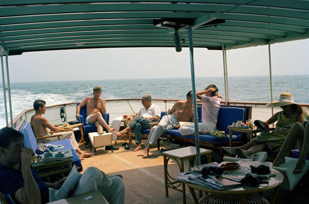 ... John F. Kennedy with Family and Friends Aboard Boat in Hyannis Port