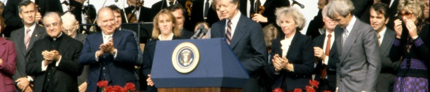 President Jimmy Carter speaks at the dedication of the JFK Library