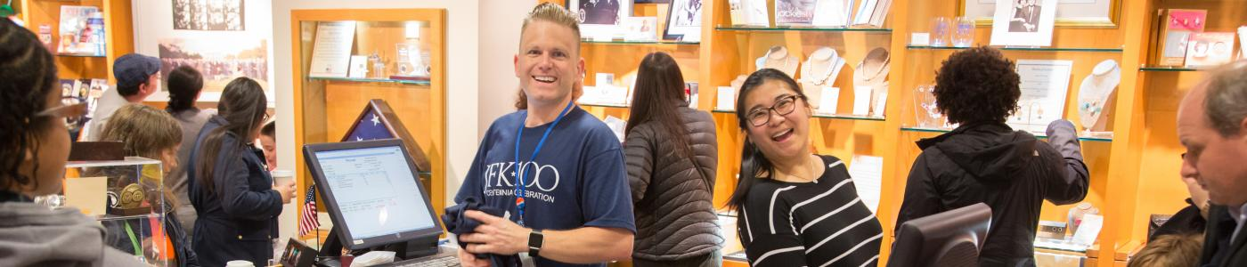 Library staff help in the museum store during the JFK 100 celebration