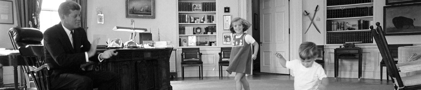 ST-441-10-62. President John F. Kennedy Watches Children Dance in Oval Office