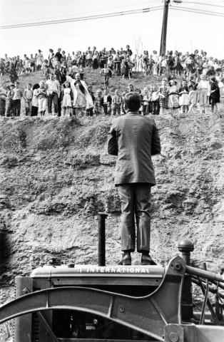 JFK speaks to a crowd from atop a tractor