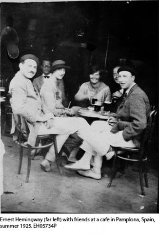 Ernest Hemingway (far left) with friends at a cafe in Pamplona, Spain, summer 1925. EH05734P