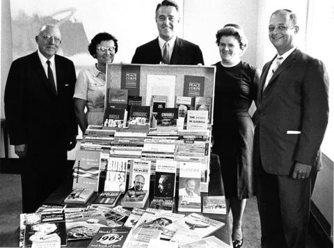 JFKPOF-086-002-p0045: Sargent Shriver and Others Examine Books for Peace Corps Volunteers, 1962