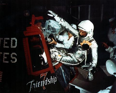 John Glenn being inserted into the Friendship 7 spacecraft on the day of his launch, February 20, 1962