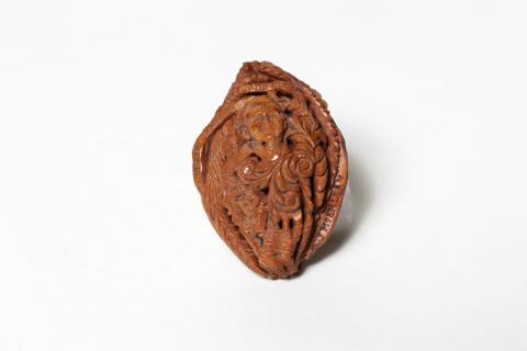 Carved Peach Pit Portrait of John F. Kennedy
