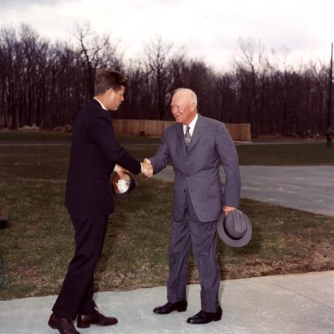 KN-C17598 President Kennedy greets President Eisenhower at Camp David, 22 April 1961.
