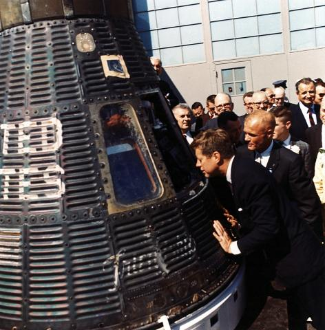 ST-A13-60-62 President Kennedy inspects the interior of the Friendship 7 Mercury capsule with Astronaut Col. John Glenn, Jr.