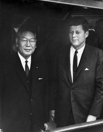 "AR6659-I. President John F. Kennedy Aboard the ""Honey Fitz"" with Hayato Ikeda, Prime Minister of Japan"